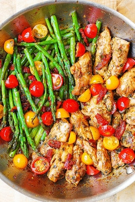 Pesto Chicken and vegetables is a great combination of flavors, colors, and makes you feel healthy just by eating it!