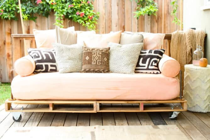 A daybed made from inexpensive pallets, and pipe that you can find at any home center.